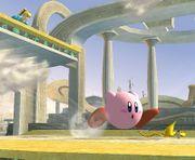 Kirby corriendo hacia una monda de plátano SSBB.jpg