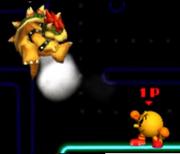 Pac-Man Usando Su Lanzamiento Delantero Contra Bowser SSB 3DS.png