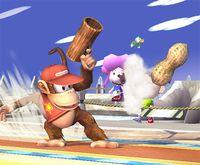 Diddy Kong disparando un cacahuate con la Cacahuetola en Super Smash Bros. Brawl