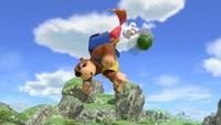 Kazooie disparando un Huevo-Granada con Banjo en el aire en Super Smash Bros. Ultimate.