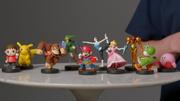 Múltiples figuras amiibo con apariencia de luchadores de Super Smash Bros.png