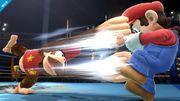 Diddy Konk usando su ataque fuerte lateral contra Mario en el Ring de boxeo SSB4 (Wii U).jpg