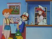 Ash, Misty y la enfermera Joy charlan, mientras que se puede observar, en el fondo de la escena, un cartel donde se ve un Dugtrio.