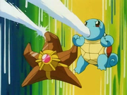EP073 Staryu y Squirtle usando pistola agua.png