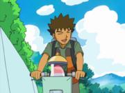 EP507 Brock en bici junto a su huevo.png