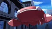 P16 Genesect Variocolor volando por la ciudad.jpg