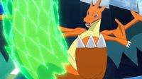 Mega-Charizard Y usando cola dragón.