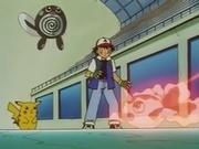 Ash y Pikachu ven como retiran a Goldeen, mientras se observa un Poliwag en la pared.