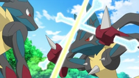 Mega-Lucario usando ataque óseo (el de la izquierda).