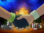 EP560 Ash y Angie dándose la mano.png