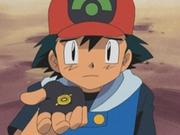 EP316 Ash devolviendo la medalla Dínamo.png