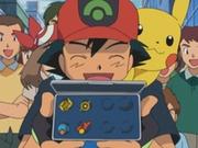 EP344 Ash mostrando sus medallas.png