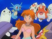 EH02 Misty junto a los Pokémon del gimnasio Celeste.png