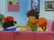 Mientras Ash, Brock y Misty charlan en el centro Pokémon, en la pared se puede ver un cuadro con una ilustración de Haunter y Gastly.