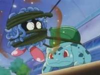 Tangela usando Paralizador contra el Bulbasaur de Ash.