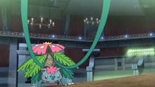 Mega-Venusaur usando Látigo cepa.