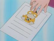 Misty muestra a Cassidy una foto de su Psyduck exigiéndole que se lo devuelvan.