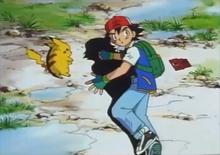 Ash con su Pokédex en el EP001.