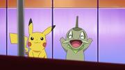 EP676 Pikachu y Axew alentando.png