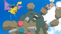 Rockruff de Ash usando mordisco (derecha).
